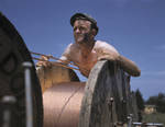 Member of a construction crew building a 33,000-volt electric power line into Fort Knox, Kentucky, United States, Jun 1942