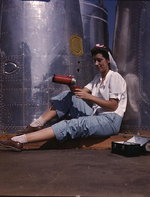 Female American factory worker taking a lunch break, Douglas Aircraft Company plant, Long Beach, California, United States, Oct 1942