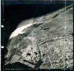 Aerial view of American bombing of Takao (now Kaohsiung), Taiwan, 1 Jun 1945, photo 1 of 4