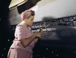 Female employee of Douglas Aircraft Company doing electrical assembly and installation work on an aircraft, Long Beach, California, United States, Oct 1942
