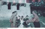 Nazi German officials purchasing bouquets of flowers from Sinti or Roma women, Bucharest, Romiania, circa 1941