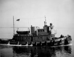 US Navy tug boat YTM 466 at the Mine Warfare School, Yorktown, Virginia, United States, 17 May 1945; the boat