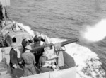 2-pounder anti-aircraft gun aboard HMCS Assiniboine firing in exercise en route between Halifax, Nova Scotia, Canada and Britain, 10 Jul 1940