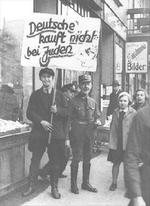 Nazi Party members boycotting a Jewish-owned store in Hamburg, Germany, 1 Apr 1933