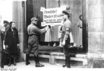 German Nazi SA men posting a boycott notice on a Jewish-owned store, Berlin, Germany, 1 Apr 1933