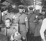 Japanese Army military policemen in a railway car, 1935