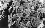 A German soldier looking at Strasbourg, France from the tower of the city