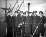 African-American crew of Liberty Ship SS Booker T. Washington after her maiden voyage, England, 8 Feb 1943; L to R: Lastic, Young, Hlubk, Blackman, Smith, Mulzac, Fokes, Kruley, Rutland, Larson