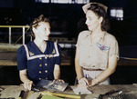 Pearl Harbor widow Virginia Young supervising trainee Ethel Mann at the Assembly and Repairs Department of Naval Air Station Corpus Christi, Texas, United States, Aug 1942