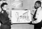 Russian Army Captain Orset Chevstov receiving a painting from African-American merchant seaman and artist George Wright, 18 Aug 1944; note painting theme of Russo-American cooperation