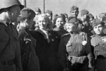 Actress Lyubov Orlova with soldiers at the Baladzhary railroad station in Baku, Azerbaijan, 1 Apr 1943