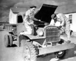 African-American US Army WAACs Ruth Wade and Lucille Mayo servicing a truck, Fort Huachuca, Arizona, United States, 8 Dec 1942