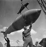 Hoisting a Tallboy bomb, RAF Woodhall Spa, Lincolnshire, England, United Kingdom, 1942-1945