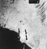 Bombing of Kalamaki Airfield, Athens, Greece, seen from the bomb bay of a US B-17 bomber, 15 Sep 1944
