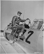 US Army Air Force pilot Captain Benjamin Oliver Davis, Jr. climbing into a Vultee AT-6 Texan aircraft, Tuskegee, Alabama, United States, Jan 1942