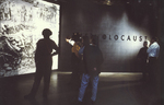 Visitors view the liberation mural on the 4th floor of the permanent exhibition of the USHMM