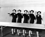 WAVES personnel posing with High Standard Model B pistols at an indoor range at Treasure Island Naval Base, California, United States, 11 Feb 1943