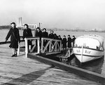 WAVES disembarking from a barge at Naval Air Station, Anacostia, Washington, DC, United States, 30 Oct 1943