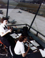 WAVES Specialist (T) 3rd Class Dorothy Knee and Specialist (T) Genevieve Close directing air traffic at Naval Air Station, Anacostia, District of Columbia, United States, in early or mid-1943