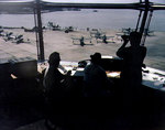 Scene in the control tower of Naval Air Station, Norfolk, Virginia, United States, overlooking a seaplane ramp full of OS2U Kingfisher aircraft, circa 1944-1945; note WAVES personnel