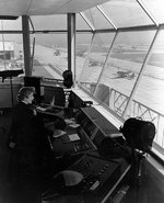WAVES Control Tower Operator at work at  Naval Air Station, Floyd Bennett Field, New York, United States, Nov 1943; note FM Wildcat and TBM Devastator aircraft in background