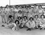 Members of the first class of WAVES to graduate from the Aviation Metalsmith School, at the Naval Air Technical Training Center, Norman, Oklahoma, United States, 30 Jul 1943
