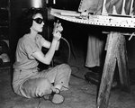 WAVES Airman 1st Class (Aviation Metalsmith) Barbara Stroud drilling and riveting aircraft structure in the Assembly and Repair Department at Naval Air Station, Jacksonville, Florida, United States, 2