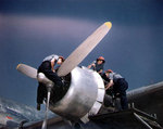 WAVES aircraft mechanics working on the port outboard Pratt & Whitney R-2000 engine of a R5D Skymaster aircraft, Naval Air Station, Oakland, California, United States, mid-1945