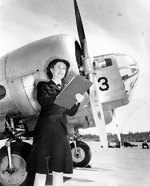 WAVES personnel Bernice Garrott marking off an aircraft check-off list, Naval Air Station, Seattle, Washington, United States, 7 Jul 1943; note SNB-1 training aircraft