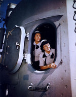 WAVES Yeoman Second Class Blanche Oswald and Yeoman Third Class Betty Martin in a 5in twin gun turret aboard Missouri, Norfolk Navy Yard, Virginia, United States, 19 Aug 1944