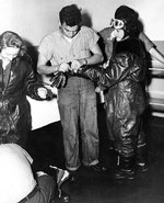 WAVES personnel putting on leather flight gear in preparation of a flight simulation,  Naval Air Station, Jacksonville, Florida, United States, 15 Oct 1943