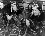 WAVES personnel putting on oxygen masks in preparation of flight simulation in chill chamber,  Naval Air Station, Jacksonville, Florida, United States, 15 Oct 1943