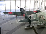 A6M Zero Model 52 fighter on display at the Yushukan Museum, Tokyo, Japan, 7 Sep 2009, photo 5 of 5; note Type 99 20-mm aircraft cannon in display case and special attack pilot statue outside