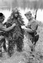 Finnish Army Major Major Martti Aho interrogating a captured Soviet soldier, Jessoila, Karelia, Finland, Aug 1941
