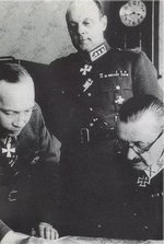 Mannerheim and Airo studying a map, circa 1941-1944; Heinrichs in background