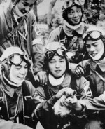 Corporal Yukio Araki (with puppy) with fellow pilots of Japanese Army 72nd Shinbu Squadron, Bansei Airfield, Kagoshima Prefecture, Japan, 26 May 1945