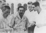 Tatsunosuke Ariizumi with German Navy submarine officers, Penang, Straits Settlements, date unknown