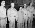US Major Hoover, US Lieutenant General George Brett, Ecuadorian Defense Minister General Alberto Romero, unidentified officer, and US Lieutenant Colonel Lucius Drafts at the Galápagos Islands, 9 Dec 1943
