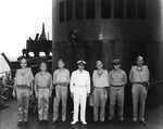 Captain Arleigh Burke (third from right) aboard SS President Monroe en route to the South Pacific, 1943