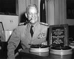 Admiral Burke in his Pentagon office, posing with the