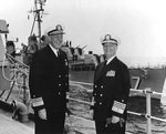 Vice Admiral Clarence E. Ekstrom and Admiral Arleigh A. Burke aboard cruiser Des Moines in the Mediterranean Sea, May 1959