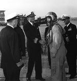 Burke, in flight suit, arrived at Naval Air Station Glenview, Illinois, US aboard an A3D jet bomber, 15 Sep 1955; meeting him were VAdm Doyle, RAdm Gallery, RAdm Forrestel, and Capt Hollingsworth