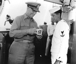 Admiral Burke and a Third Class Quartermaster on bridge of destroyer Picking, circa 1955-1961