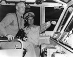 Admiral Burke on the bridge of carrier Forrestal with the ship
