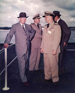 President Eisenhower, Admiral Burke, and Presidential Naval Aide Captain Evan P. Aurand aboard USS Saratoga, 6 Jun 1957