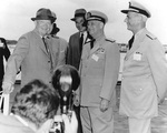 US President Dwight Eisenhower, Secretary of the Navy Thomas Gates, Jr., Admiral Arleigh Burke, and Admiral Jerauld Wright aboard USS Saratoga, 6 Jun 1957