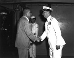 Japanese Admiral (ret.) and former Ambassador to United States Nomura shaking hands with American Rear Admiral Burke aboard cruiser Los Angeles in Japanese waters, 22 Jun 1951