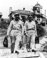 Major General Henry I. Hodes and Rear Admiral Arleigh A. Burke leaving the
