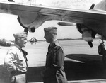 RAdm Gerald Bogan and Commodore A. Burke, Naval Air Station Norfolk, Virginia, United States, summer 1946; note wing of R5D Skymaster aircraft and TBF Avenger, SNJ, and SB2C Helldiver in background