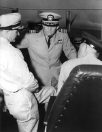 US Navy Captains Charles Weakley and Arleigh Burke, US Air Force General J. T. McNarney aboard destroyer Sarsfield during anti-submarine demonstration off Key West, Florida, United States, 23 Feb 1950
